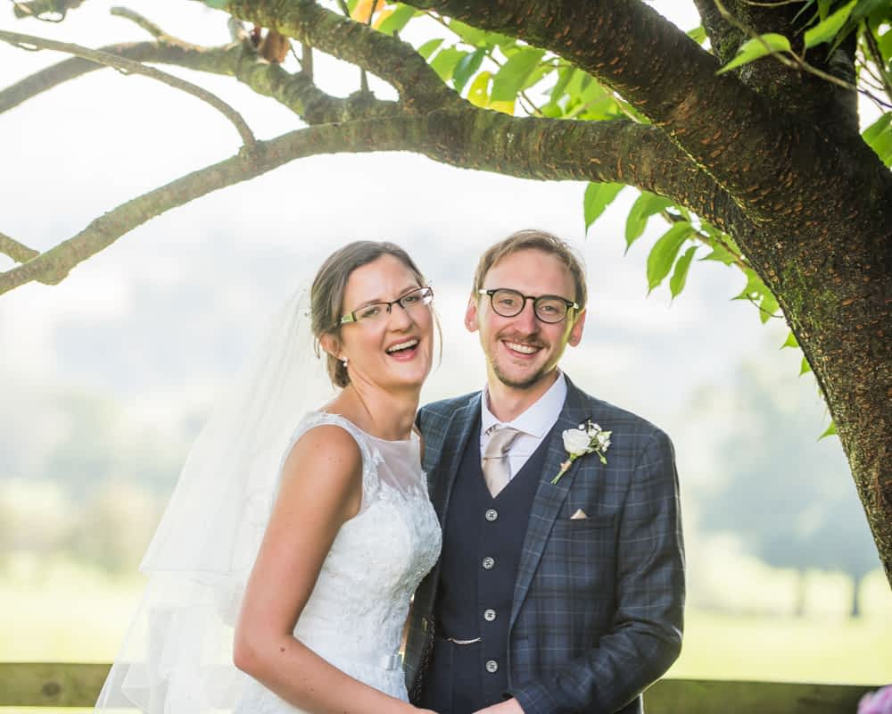 Bride and groom laughing, Shireburn Arms, Lancashire wedding photographers