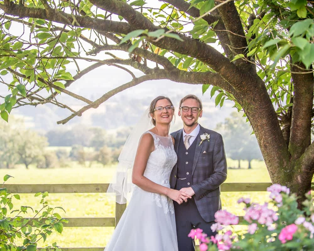 Posing in summery grounds, Shireburn Arms, Lancashire wedding photographers