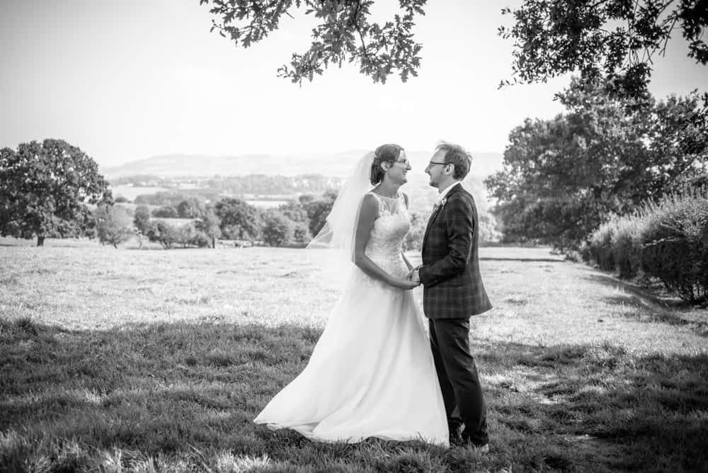 Posing in nearby fields, Shireburn Arms, Lancashire wedding photographers