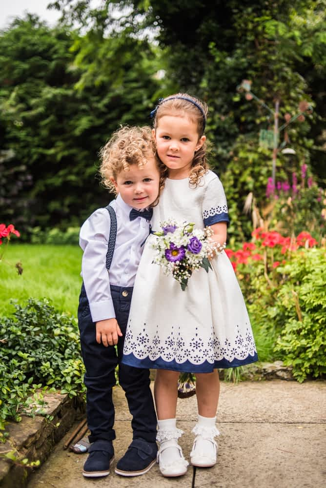 Pageboy and flower girl posing, Shireburn Arms, Lancashire wedding photographers