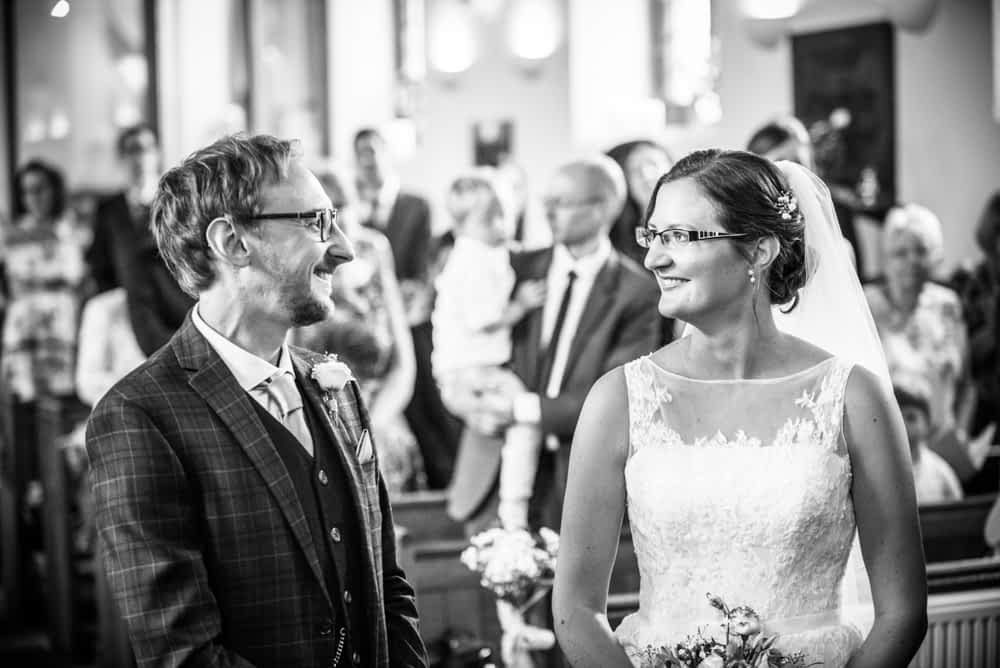 Bride meets groom at top of aisle, Shireburn Arms, Lancashire wedding photographers
