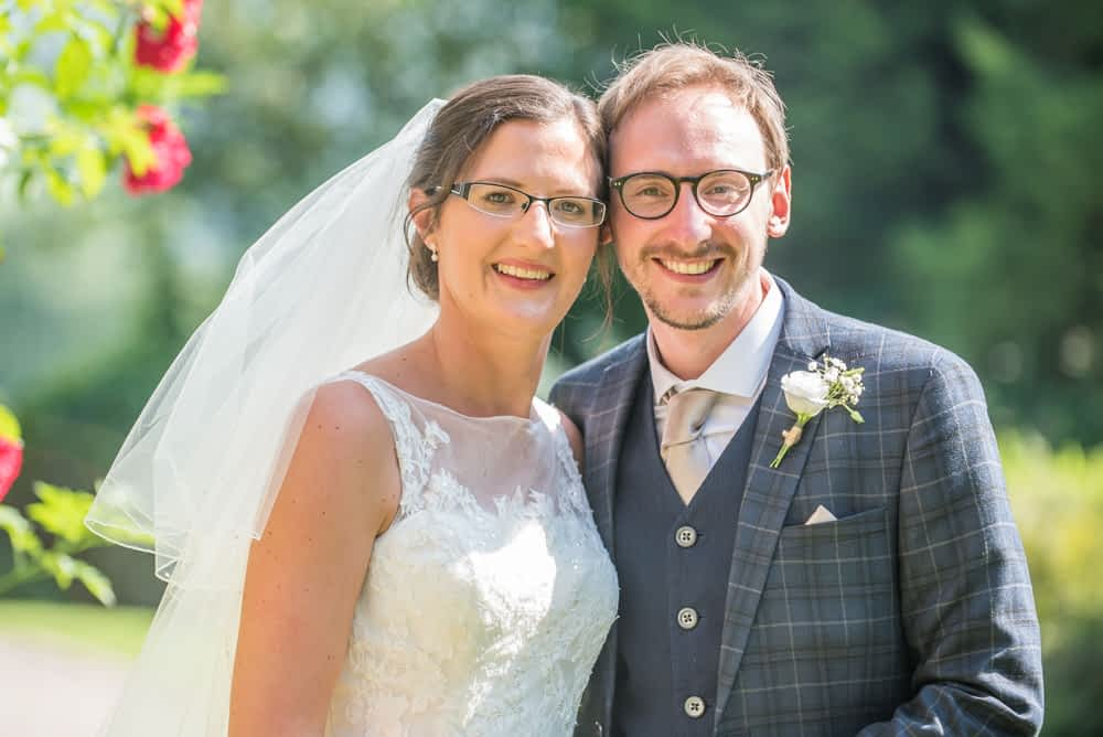 Bride and groom posing in sunshine, Shireburn Arms, Lancashire wedding photographers