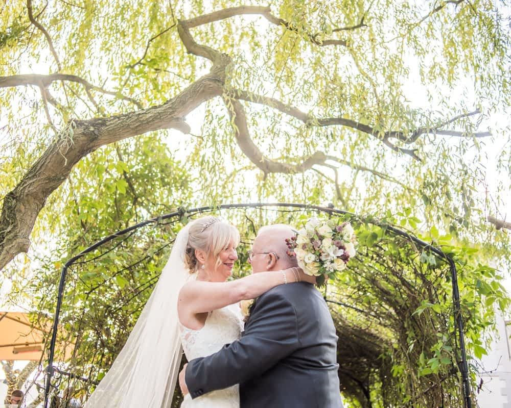 Under the tree arch at the wedding venue,  Hotel Van Dyk wedding photography Chesterfield