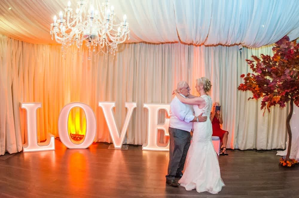 First dance next to love sign,  Hotel Van Dyk wedding photography Chesterfield
