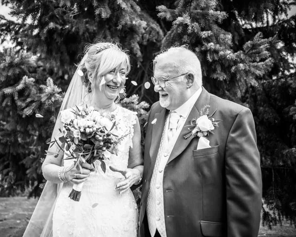 Happy confetti laughter,  Hotel Van Dyk wedding photography Chesterfield
