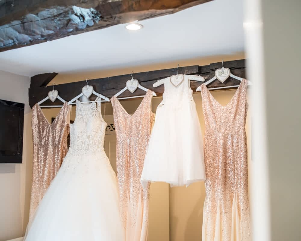 Bride and bridesmaids dresses hanging up, Waterton Park Hotel weddings, Yorkshire wedding photographers