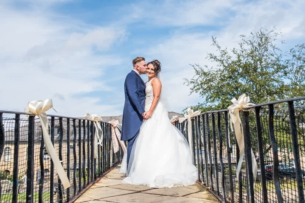Kiss on top of the bridge, Waterton Park Hotel weddings, Yorkshire wedding photographers