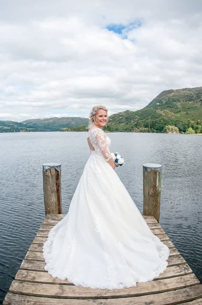 Bride and dress on jetty, Inn on the Lake Weddings, Lake District